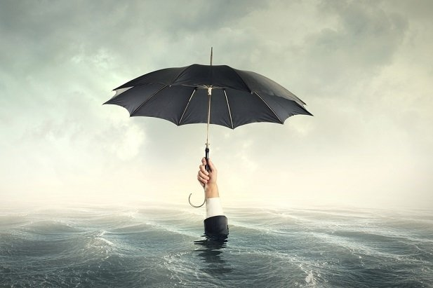 hand barely above water holding umbrella