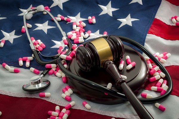 Gavel on American flag with stethoscope
