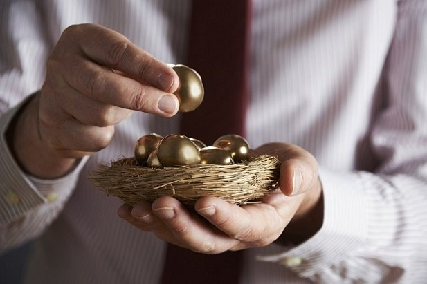 man holding golden egg and nest