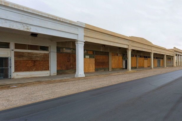 boarded up shopping mall
