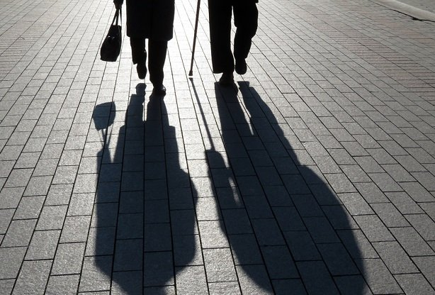 shadows of elderly couple walking