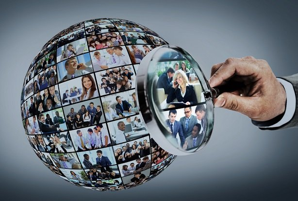 magnifying class focuses on world made of business people photos