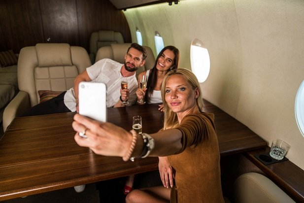 three young people on a private jet