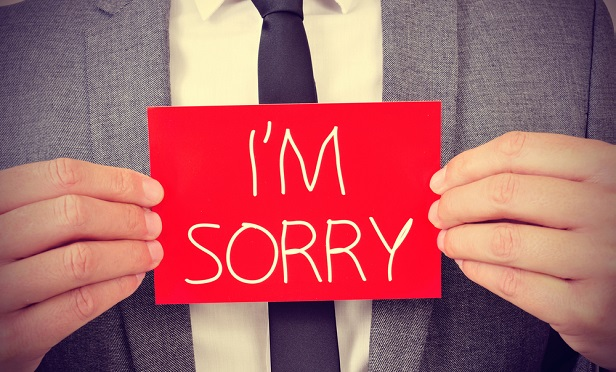 "Man with ""I'm sorry"" sign"