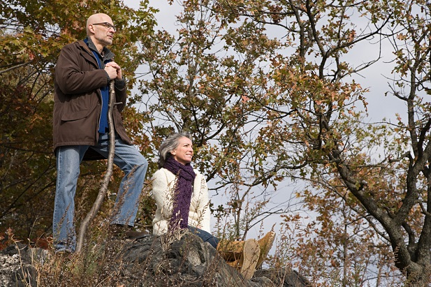older man and woman hiking