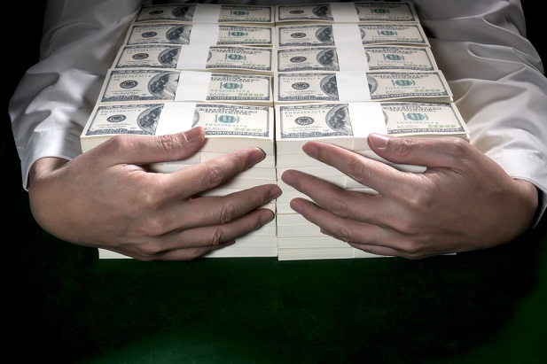 man holding millions of dollars