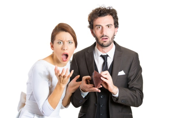 outraged man and woman with empty wallet