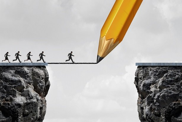 business people running along giant pencil line over cliff