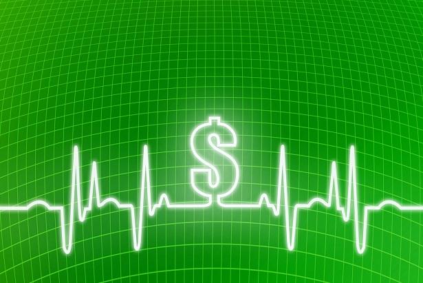 EKG heart waves with dollar sign