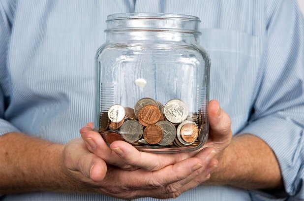 Man holding coin jar