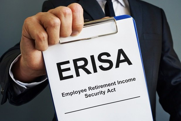 man hand holding paper with ERISA on it