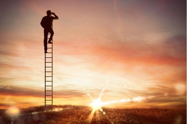 man on ladder with binoculars