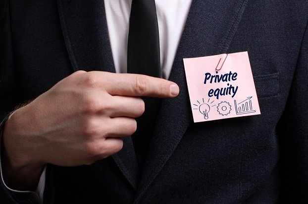 man in suit pointing to private equity sign on pocket