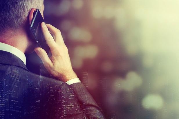 older business man talking on smartphone