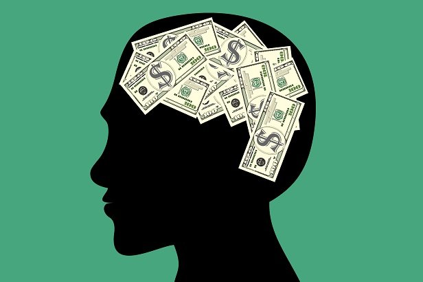 drawing of head with money in place of brain