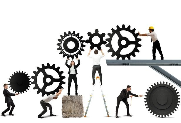 business people moving gears