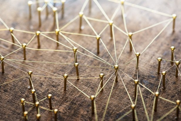 network of golden pins connected by wire