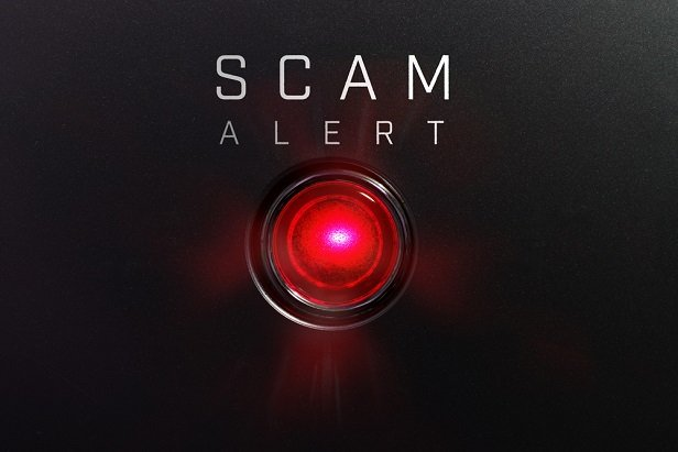 red button with word Scam Alert beside it