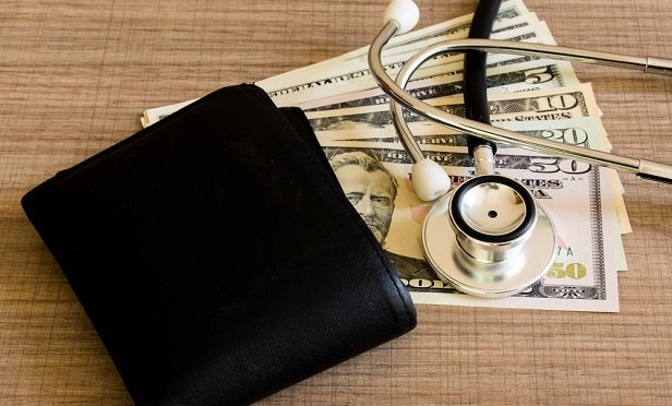 Wallet, cash and stethoscope