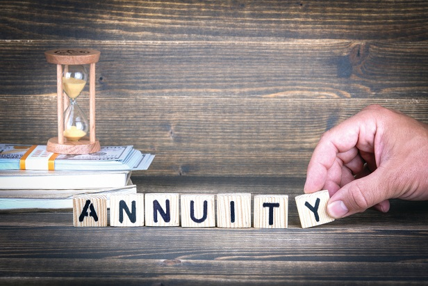 letter tiles and hand using them to spell out annuity