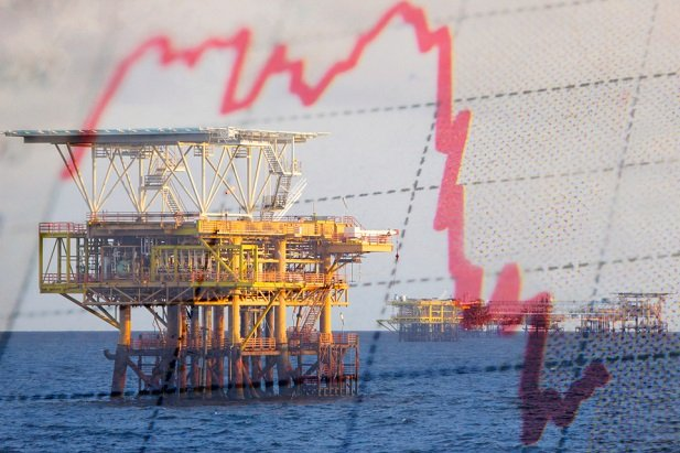 ocean oil rig collaged with downward stock chart arrow