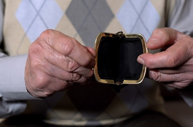 man hands holding an empty coin purse