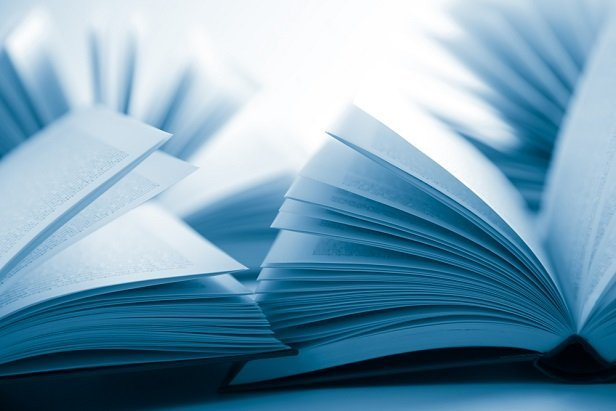 closeup of books with fanned out pages