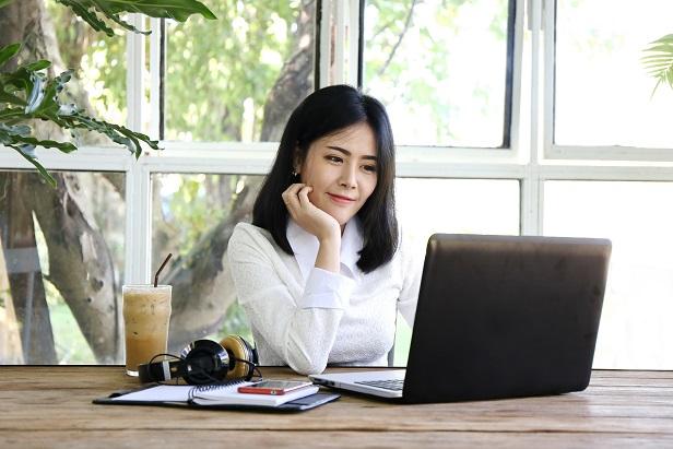 business woman at computer thinking