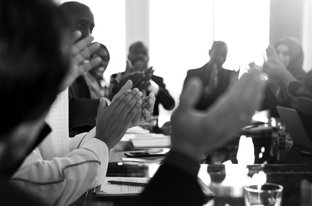 people blurred in meeting clapping