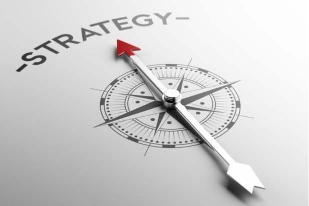 Compass arrow pointing at the word Strategy