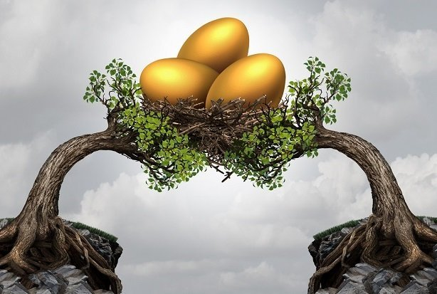 two tilting trees holding one heavy next with golden eggs