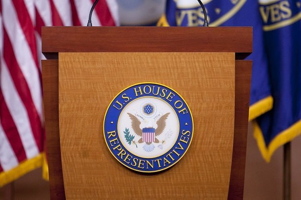 U.S. House of Representatives seal on the podium of the media briefing room in the Capitol building, 2014