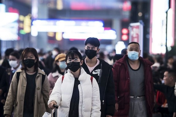 people on city street wearing face masks