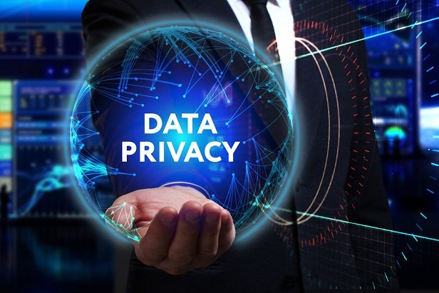 business man holding see thru globe labeled Data Privacy