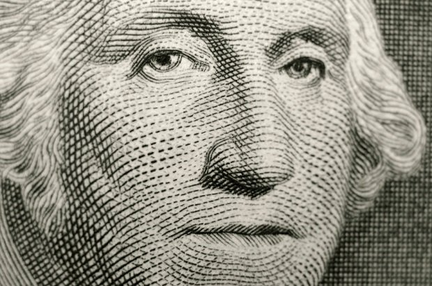 dollar bill showing closeup of Geo Washington's face on it