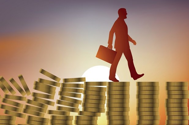 stylized man with briefcase walking across collapsing columns of coins