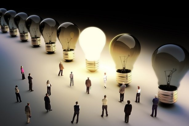 collage of lightbulbs with workers standing around a lit one that's larger than they are