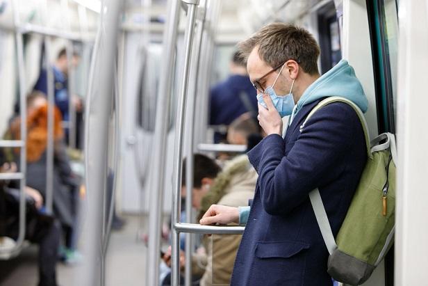 man on subway wearing face mask
