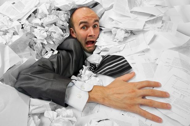 business man or gov employee drowning in paperwork
