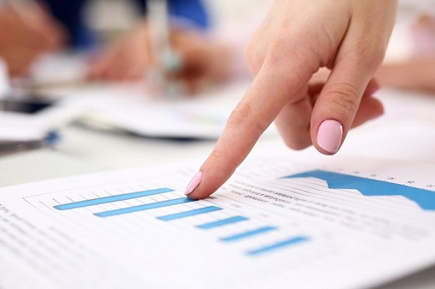 woman's finger pointing to chart