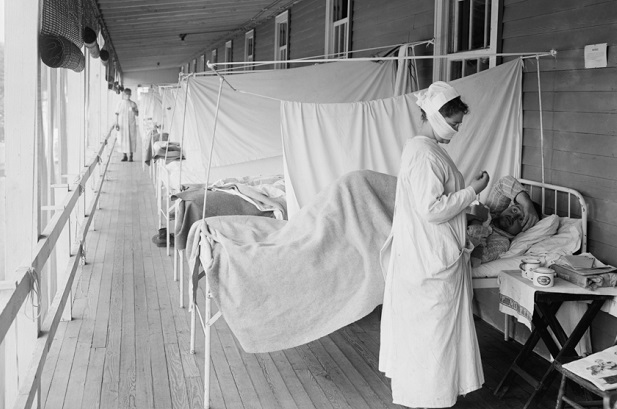 nurse tends to patient on porch of Walter Reed Hospital in 1918