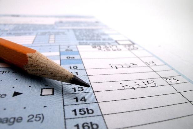 pencil resting on tax form