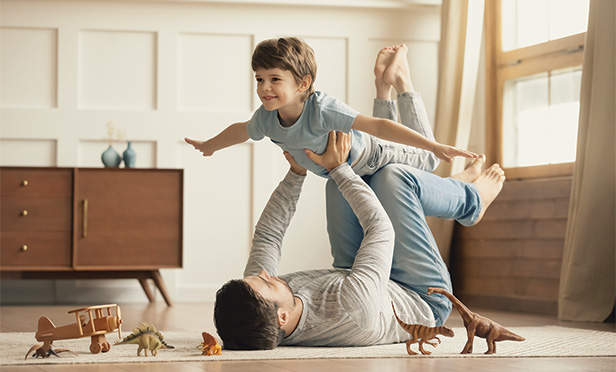Man holding son up in the air