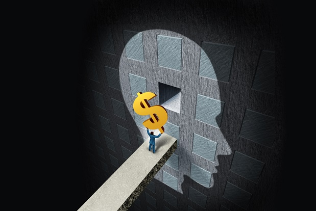 illustration of person shoving giant dollar sign into square in head-shaped blocks on a wall