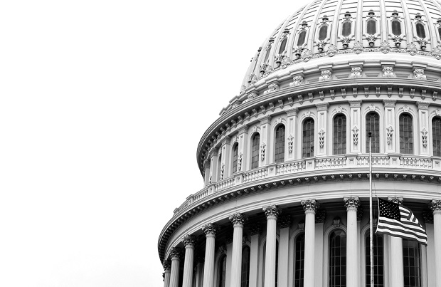 black and white closeup of dome of nation's capitol building