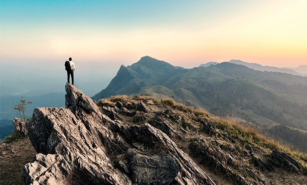 Man standing on mountain ridge
