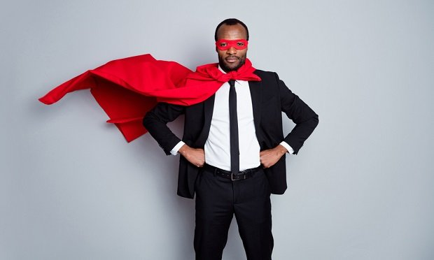 Businessman with red cape and mask