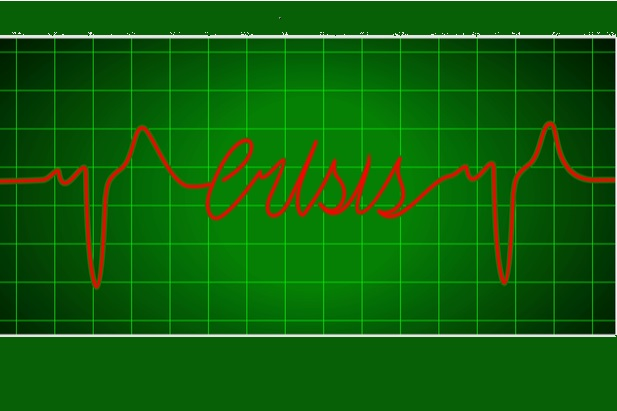 green grid with the word crisis in red that is part of an ekg line