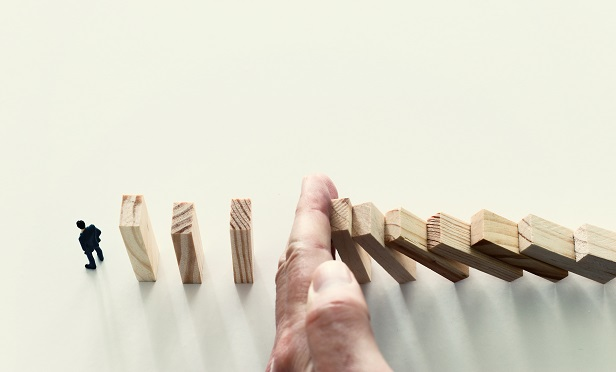 Hand blocking domino blocks from falling