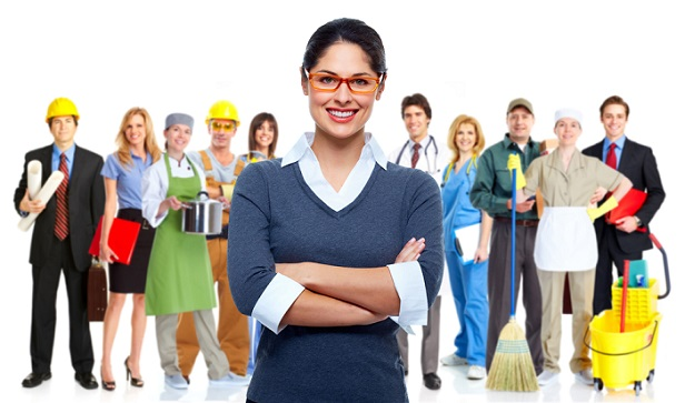 employees from white and blue collar jobs lined up behind young woman in sweater and glasses